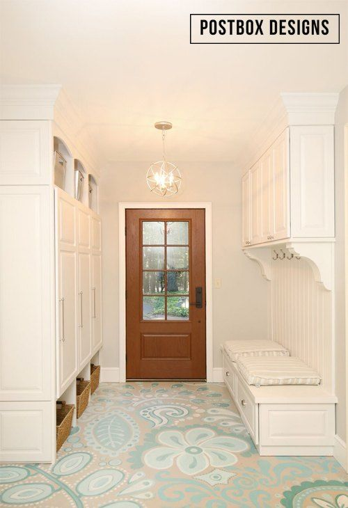 An old and drafty breezway is updated and remodeled into a usable mudroom with a beautifully painted concrete floor.