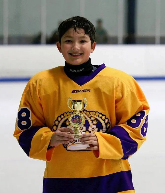 Hockey player Sean Dolim, LA Junior Kings Defenseman #88. Awarded MVP Trophy for Game 3 of the Thanksgiving Tournament. Yay Sean!!