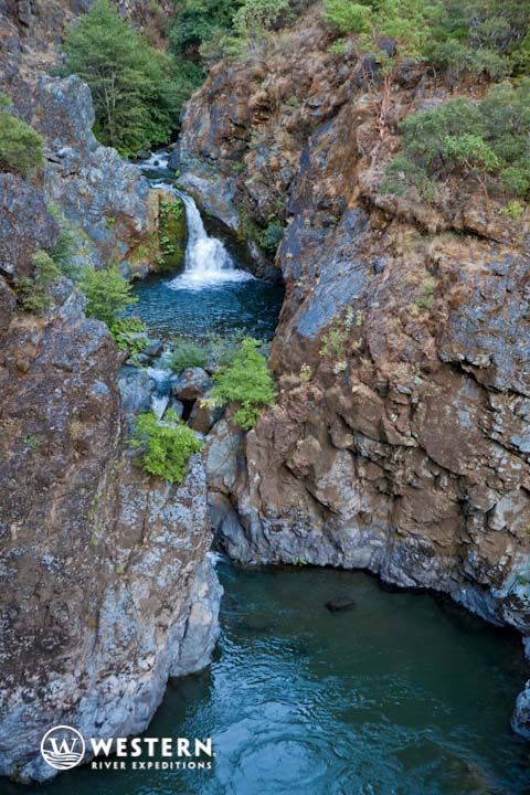 A waterfall cascades into the Rogue River in Oregon. Amazing views from a Rogue River rafting trip.