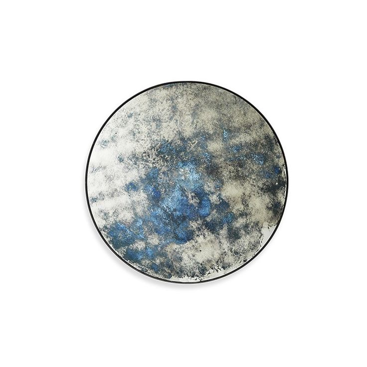 A manipulation of mirrored glass creates a multidimensional finish in blue. Entirely patinated or part-distressed, modern mirrors are being given a classic twist.