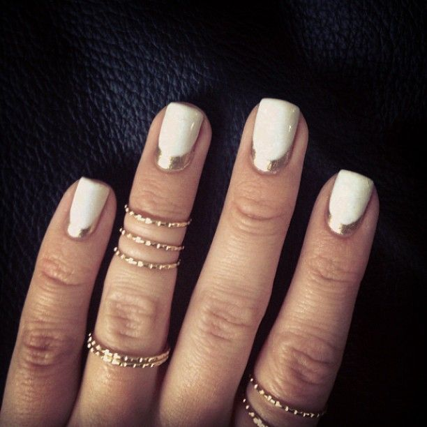 White nails with a silver reverse french mani.