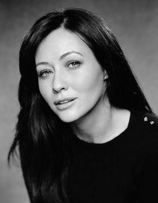 "Shannen Doherty as Prudence ""Prue"" Halliwell"