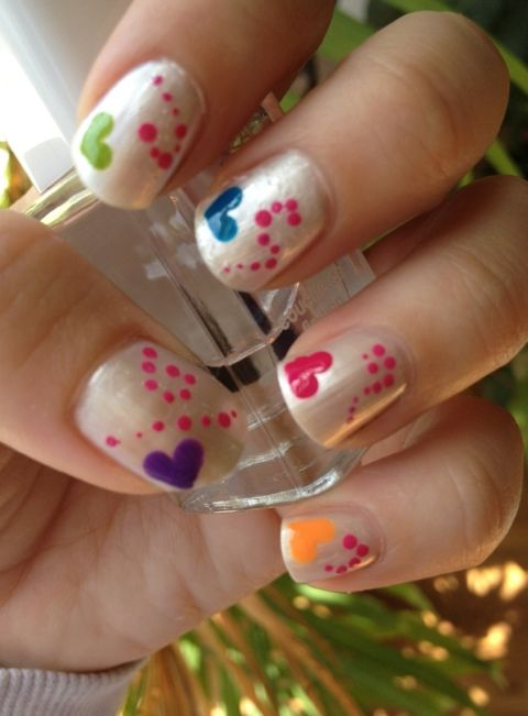 Colorful Heart Nail Design.. I see my daughter wanting this