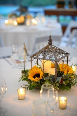 A lovely cage lantern with sunflowers and candles for a summer wedding at Willowdale Estate - willowdaleestate.com (266x400)