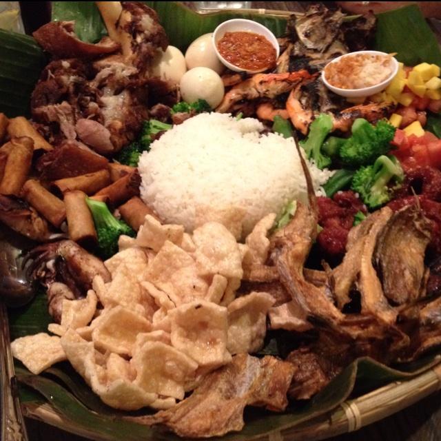 Kamayan Platter @ Isla Restaurant     - Inihaw na Bangus (grilled milkfish), Inihaw na Liempo (grilled pork belly), Inihaw na Pusit (grilled squid)  - Inihaw na Hipon (grilled shrimp)  - Tortang Dulong (fried fish fry cakes), Crispy Pata (deep-fried pork knuckles), Pork Longganisa (sausage), Crispy Fish, Taba ng Talangka (crab roe paste from small shore crabs), Balo-balo (fermented rice with fish), Ensalada (mango and tomato salad), Steamed Vegetables, Hard Boiled Eggs, Lumpia
