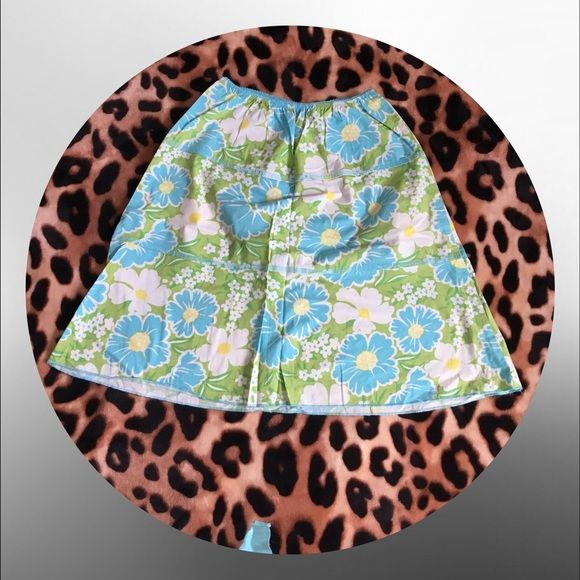 • Super cute Hawaiian skirt • Green skirt with blue and white flowers. New. Bundle to save. Skirts