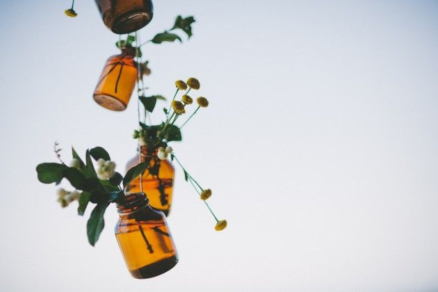 Hanging upcycled glass vases