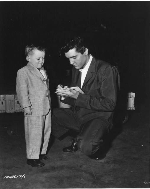 Adorable. Elvis signing an autograph while filming KING CREOLE, 1958