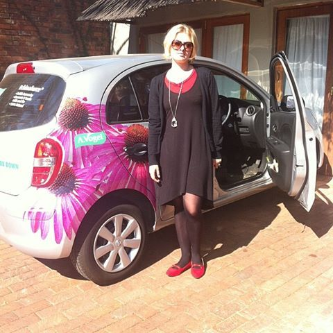 Esrida has just stepped out her newly branded car.