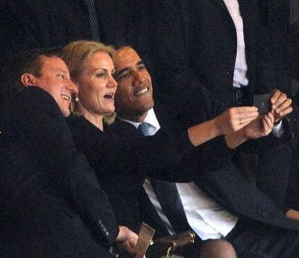 The Danish Prime Minister takes a selfie with the British Prime Minister and U.S. President Barack Obama, at the Nelson Mandela Memorial, 12/10/13.