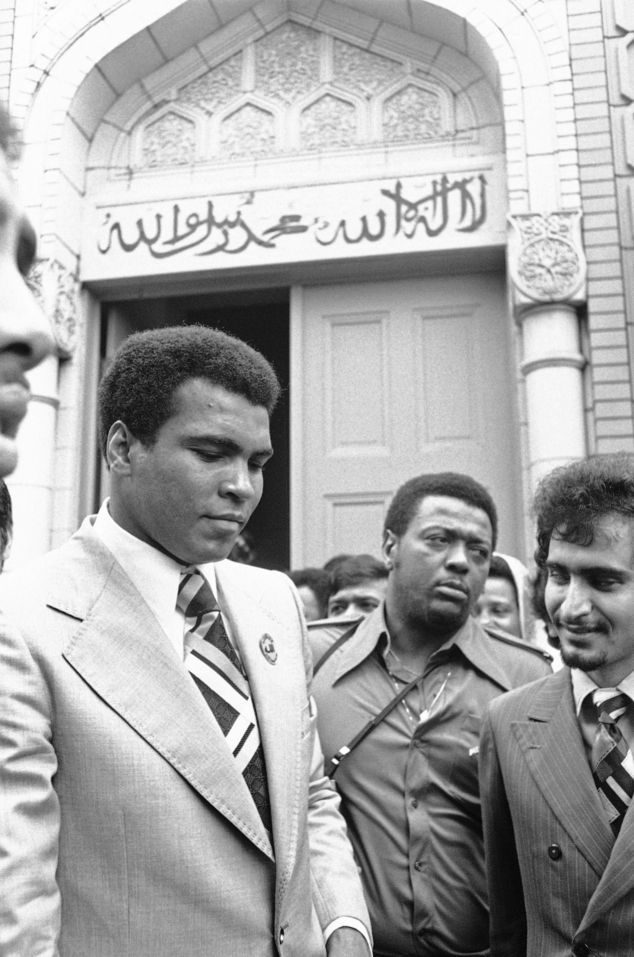 Ali (left) steps out of a Muslim mosque in Tokyo in June 1976. The day before his star-studded funeral, members of Muhammad Ali's Islamic faith will get their chance to say a traditional goodbye to the Champ
