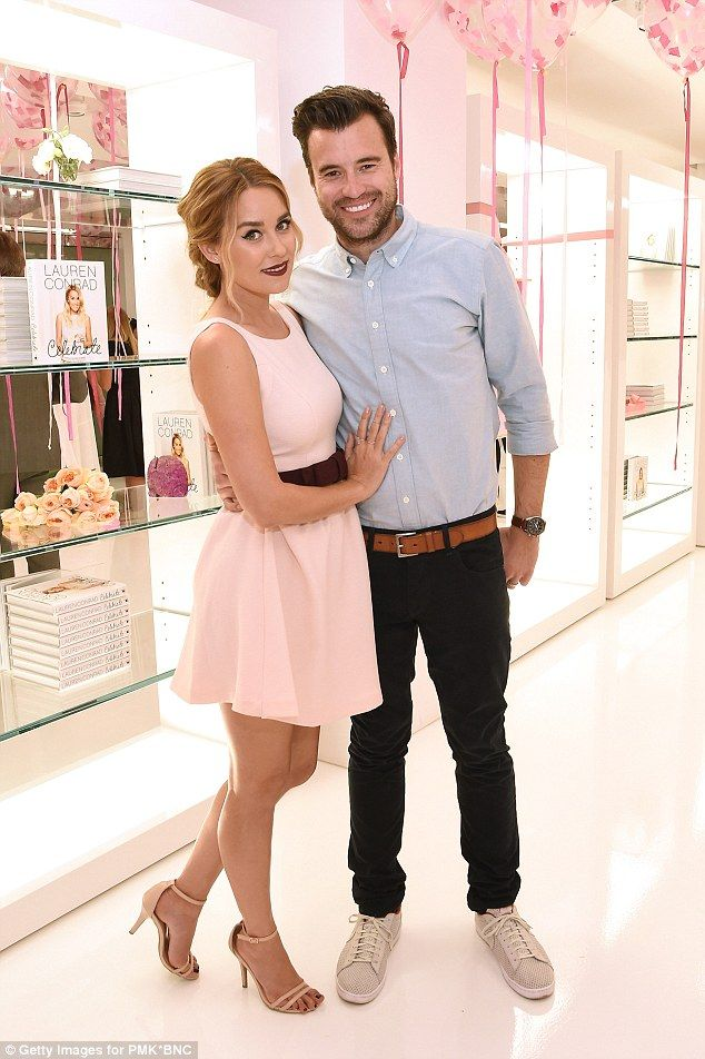 Picture perfect! Lauren Conrad and her husband William Tell looked to still be enjoying the early stages of marital bliss as they cosied up together during a launch party for the reality star's new lifestyle book, Lauren Conrad Celebrate, in New York on Wednesday