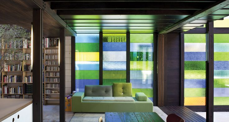 A multi-coloured glass screen wall inside James Russell Architect's Raven Street House in Brisbane