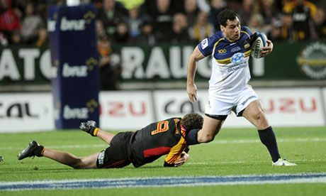 Super Rugby final: George Smith slips the tackle of the Chiefs' Tawera Kerr-Barlow