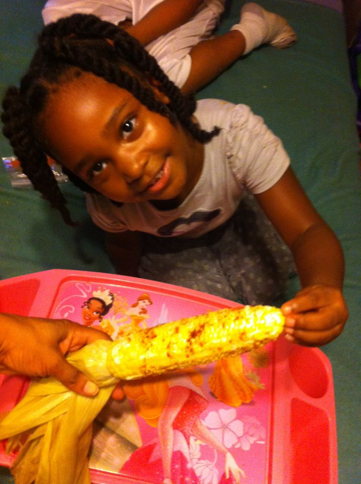 We love corn n she pose with it