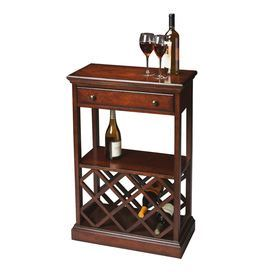 """Wood wine rack with cherry veneers and antiqued brass hardware.      Product: Wine rackConstruction Material: Solid wood and veneer Color: Plantation cherry      Features:    Antique brass hardware Holds eight wine bottles       Dimensions: 37.25""""  H x 23.25""""  W x 12""""  D      Cleaning and Care: Wipe with a soft dry or slightly dampened cloth. Periodic use of a quality furniture oil to nourish the wood is recommended."""