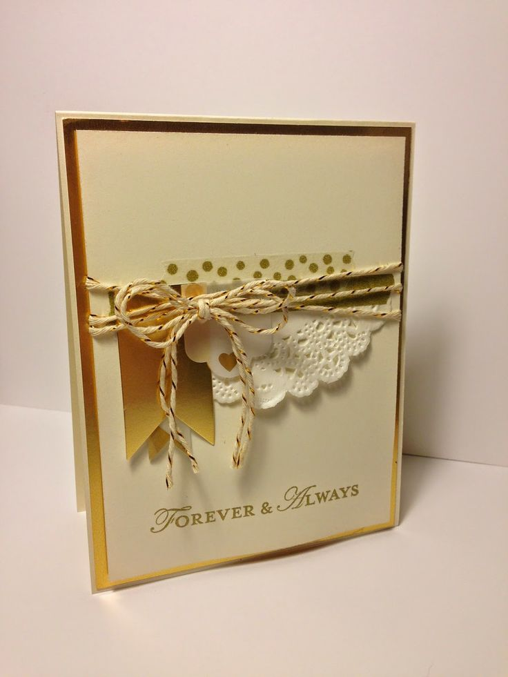 Features Stampin Up gold foil paper, gold washi tape, doily, gold bakers twine for an elegant wedding card