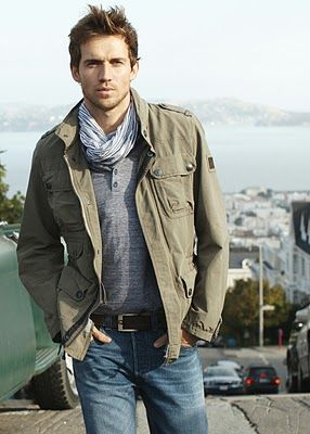 Army green jacket and gray scarf. Andrew Cooper. Note how the gray shirt acts as a neutral base layer.