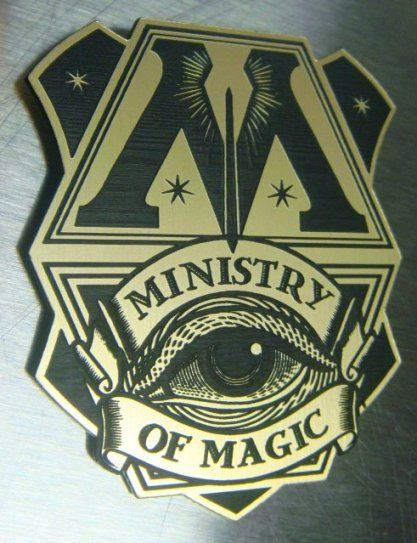 Offered here is a CUSTOM MINISTRY OF MAGIC AURORS BADGE! Made of sturdy, laser engraved, brass-colored plastic (looks like metal). Measures 2.5