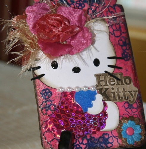 Hello Kitty tag I made with Lindy's Stamp Gang magical micas, sizzix bigz die and trims