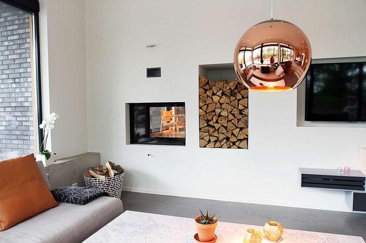 A modern fireplace | Villa E by Stringdahl Design