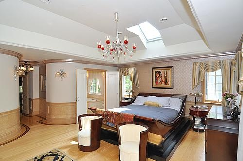 Master bedroom with vaulted ceiling, Juliette balcony and fireplace