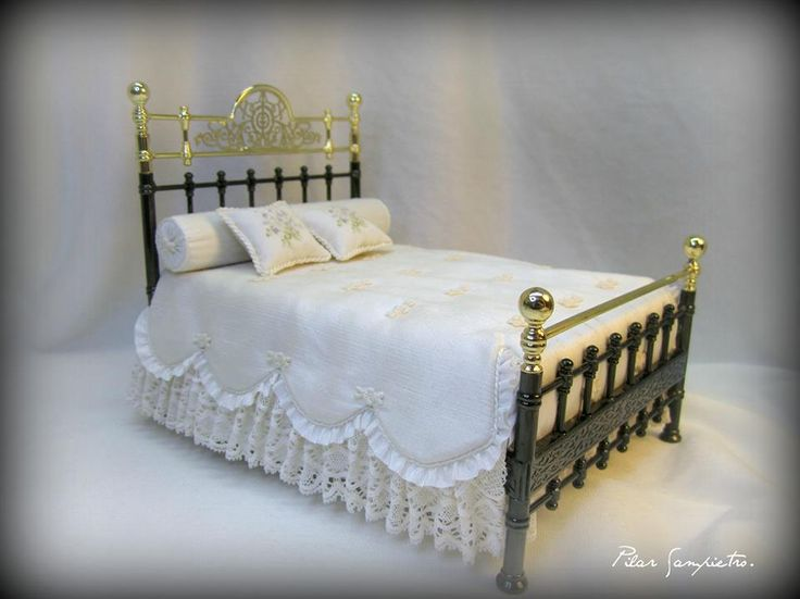 Brass Bed with White Lace Bedding