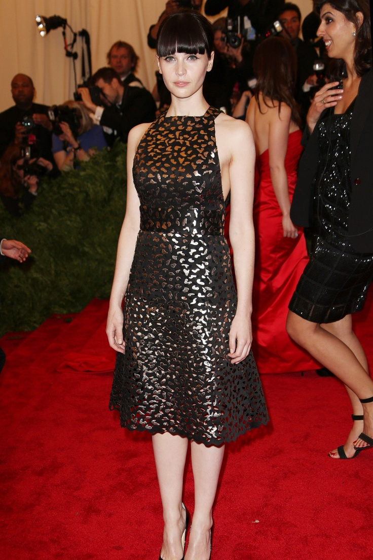 Felicty Jones' Proenza Schouler laser-cut cocktail dress had a gold metallic bodice beneath