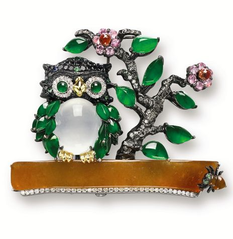 MULTI-COLOURED JADEITE, GEM-SET AND DIAMOND 'OWL' BROOCH, MASON TSAI Modelled as an owl resting on a yellow jadeite twig next to a blossoming tree, the owl's body set with a translucent oval icy jadeite cabochon, the head set with black diamonds accented by tsavorite garnets and jadeite-set eyes, the feathers and tree leaves set with jadeite cabochons, decorated by flowers set with coloured sapphires, the diamonds together weighing approximately 1.50 carats, mounted in 18 karat blackened…
