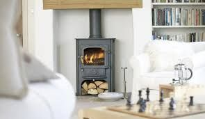 Image result for contemporary wood burning stoves with separate wood stores