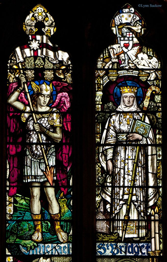 St Michael and St Bridget.  Michael is standing on a dragon. St Michael's Parish Church in Linlithgow, Scotland.