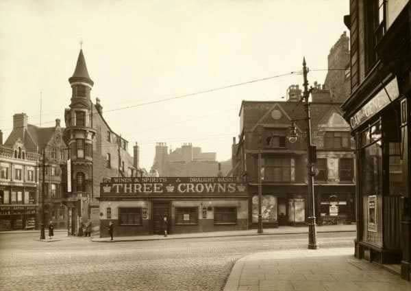 Upper Parliament Street, 1928  The junction with Market Street from the bottom of Wollaton Street showing the Three Crowns. Taken before the road widening scheme.