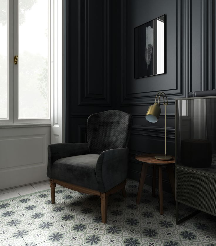 Black Tie Home Decor catalogue by Linee Studio. Black velvet Dafne armchair in a total black environment featuring moroccan tiles flooring.