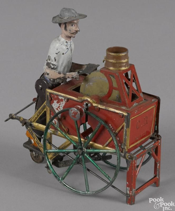 Charles Rossignol hand painted tin knife grinder cart toy with a flywheel, 5 1/2'' l. - Price Estimate: $400 - $600