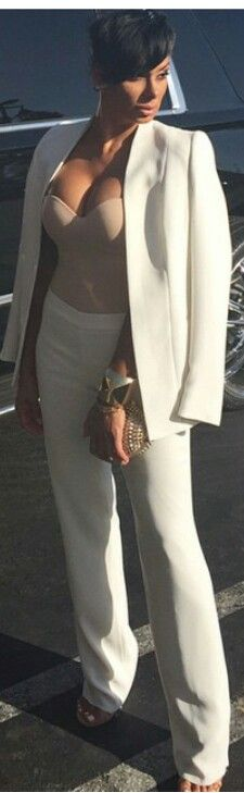 Laura Govan in Bustier off white pants suit | That bustier might do better as an under-garment . . .  specifically.