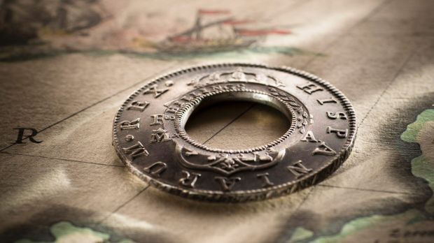 Lachlan Macquarie modified Spanish coins to create Holey Dollars, Australia's first coins.