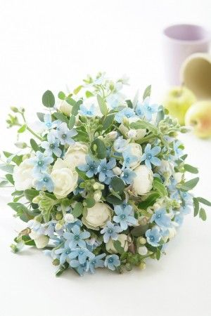 Pretty Forget Me Nots with white rose buds.