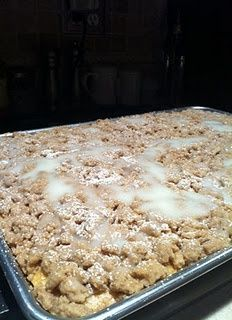 Cinnamon Crumb Coffee Cake    For the cake:    1 box yellow cake mix  1 1/4 c. sour cream  1/3 c. vegetable oil  3 eggs  1 t. cinnamon  1/2 t. nutmeg    Preheat oven to 350. Grease and flour a 15x10x1 inch pan. Mix all cake ingredients together with an electric mixer on medium until well combined. Bake for 20 minutes or until a toothpick inserted n