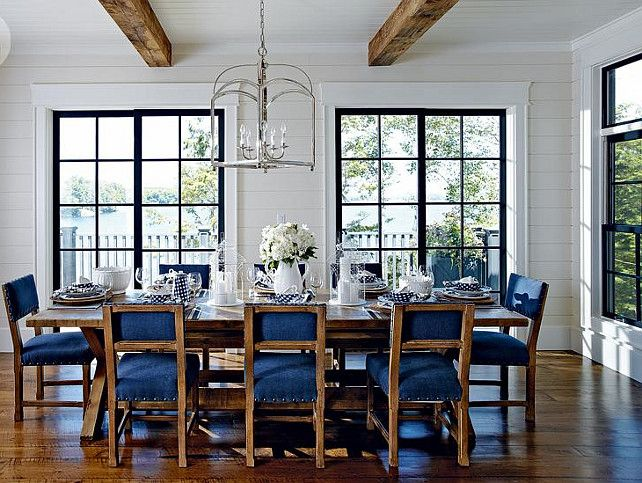 Lake Muskoka Cottage with Coastal Interiors.  The dining room is bright and well-decorated in its simple way. The designer wanted to keep the decor simple to highlight the millwork and wooden windows.