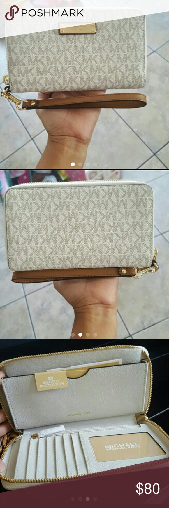 NWT Michael Kors Large Wristlet Wallet New with tags. Michael kors large wristlet wallet. Compatible with most phones like the iPhone plus Prefer to sell on M for less Michael Kors Bags Wallets