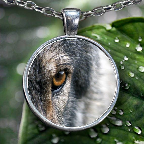 Wolf Necklace - Wolf Eye Necklace Pendant  This Wolf Eye Pendant shows part of the Wolf Head or Face with focus on the eye. Very cool, intimidating wolf eye.  **Wolf Eye Pendant Necklace - Choice of Silver Plated or Gun Metal.  **This Wolf Eye Necklace comes Silver plated Or Gun Metal with a clear glass cabochon that magnifies and protects the beautiful design underneath. Shows the highest quality color and vibrance in your necklace as possible.   *****You can also use your pendant as a…
