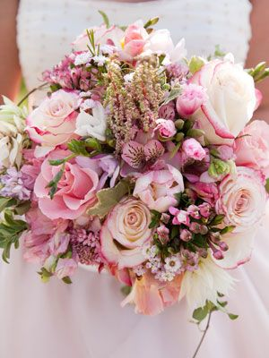 Carry a Soft Pink Bouquet Get your girlie details right -- as with this blend of a variety of pink flowers to create a bouquet that's totally feminine but still elegant.