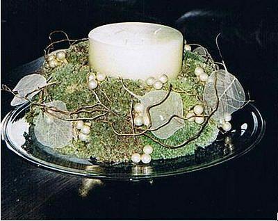 Sobere adventskrans van bolmos met ecru tinten zelf maken om de advent te vieren