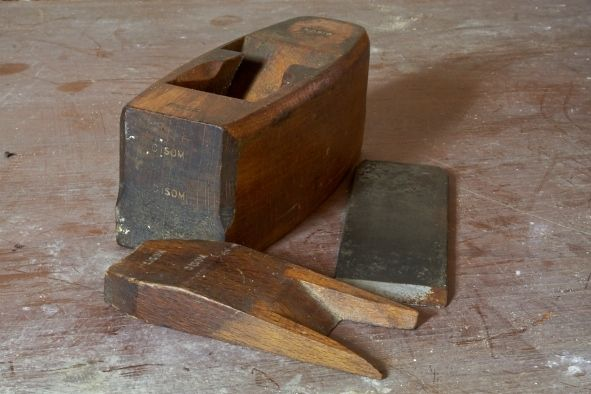 Old wooden hand plane before being restored