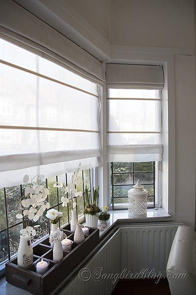 How to make double layered Roman blinds so you can leave the light shades down in the day to filter light, and the darker shades at night to block from the road/outer lights, etc. Nice.
