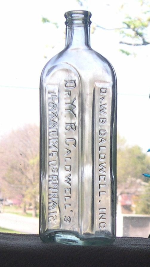 1910's large W.B. Caldwells pale green glass bottle. This bottle has the YY style of W on the front. Well defined embossing.