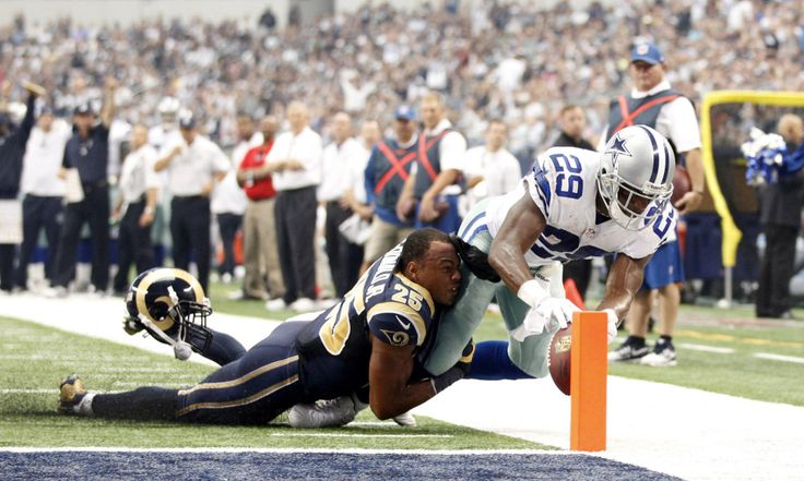 Sep 22, 2013; Arlington, TX, USA; Dallas Cowboys running back DeMarco Murray (29) scores a touchdown while being tackled by St. Louis Rams strong safety T.J. McDonald (25) in the second quarter of the game at AT&T Stadium. Mandatory Credit: Tim Heitman-USA TODAY Sports