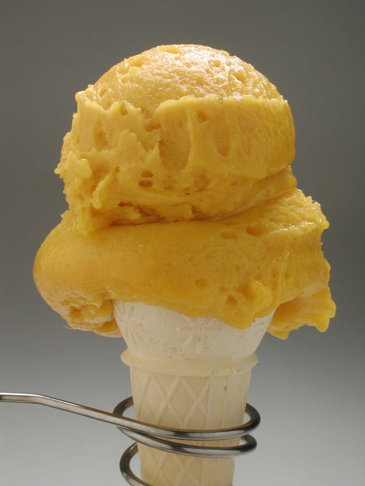 Alfonso Mango Sorbet in a cone!!   Real Mangoes. 80 percent Fruit Content. No water added! Dairy free and Vegan!