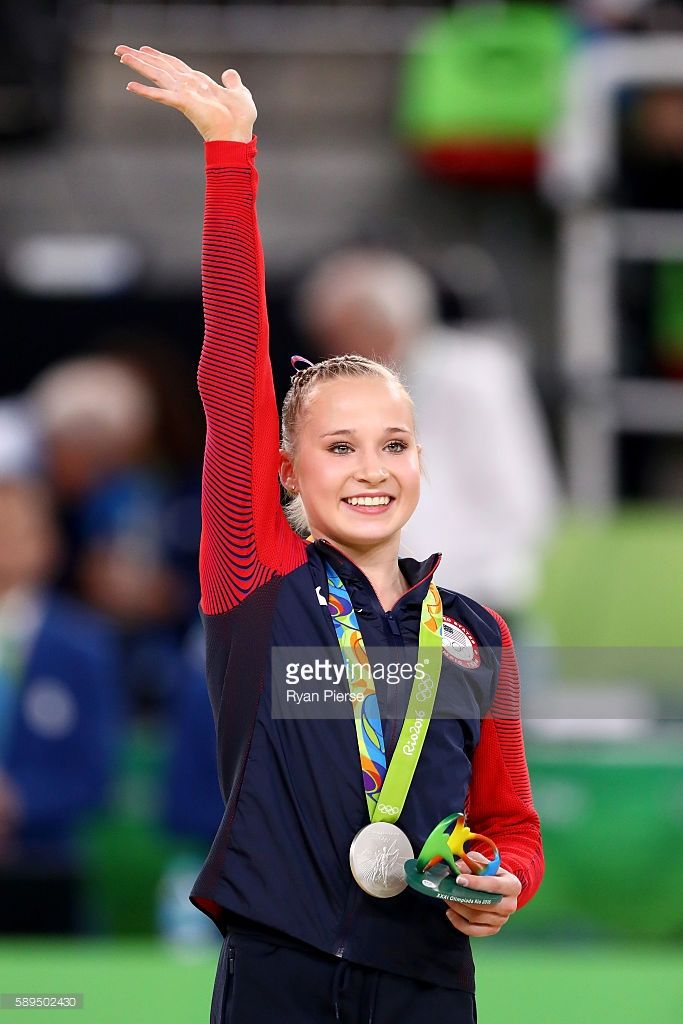 Silver medalist Madison Kocian of the United States celebrates on the podium at the medal ceremony for the Women's Uneven Bars on Day 9 of the Rio 2016 Olympic Games at the Rio Olympic Arena on August 14, 2016 in Rio de Janeiro, Brazil.