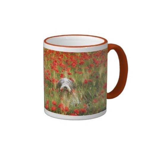Bearded collie Niki in poppies field. Coffee mug